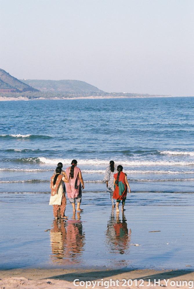 Women paddling in sea, Eastern India