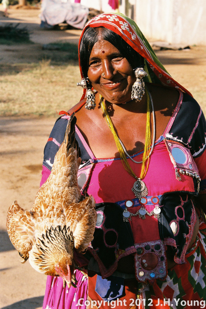 village women with chicken