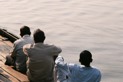 Men sitting by river