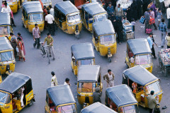 swarms of motorized rickshaws