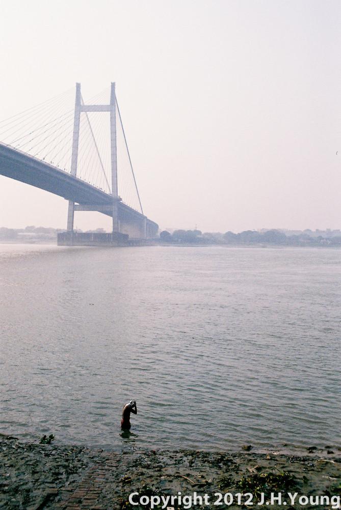 Bathing in the Hooghly river KolKata